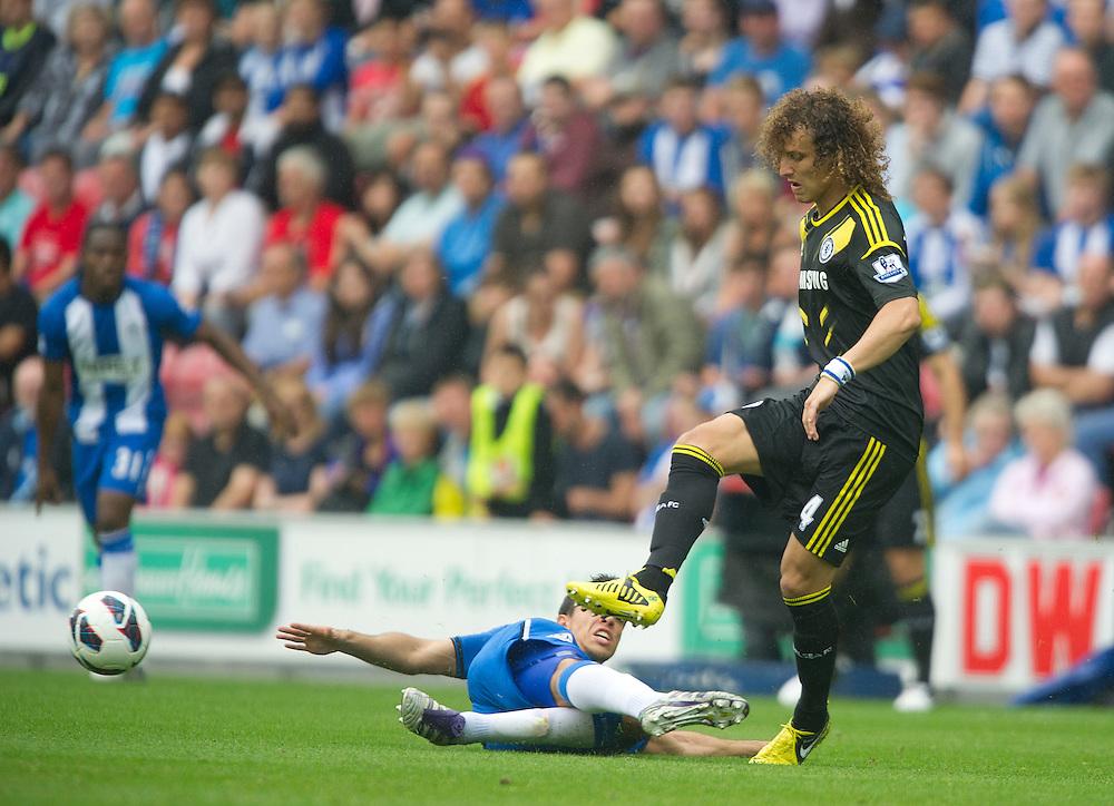Chelsea's David Luiz is tackled by Wigan Athletic's Franco Di Santo ..Football - Barclays Premiership - Wigan Athletic v Chelsea - Sunday 19th August 2012 - DW Stadium - Wigan..