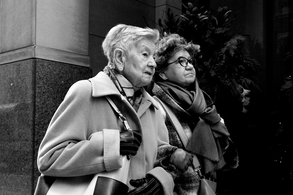 Walking on Bay Street near Christmas time, I always have my camera in hand at the ready. I saw these two lovely well-dressed ladies walking up the street hand and hand and quickly made a photograph. I loved the intimate moment and their connection. Looking at the photo now I think it is daughter and mother.