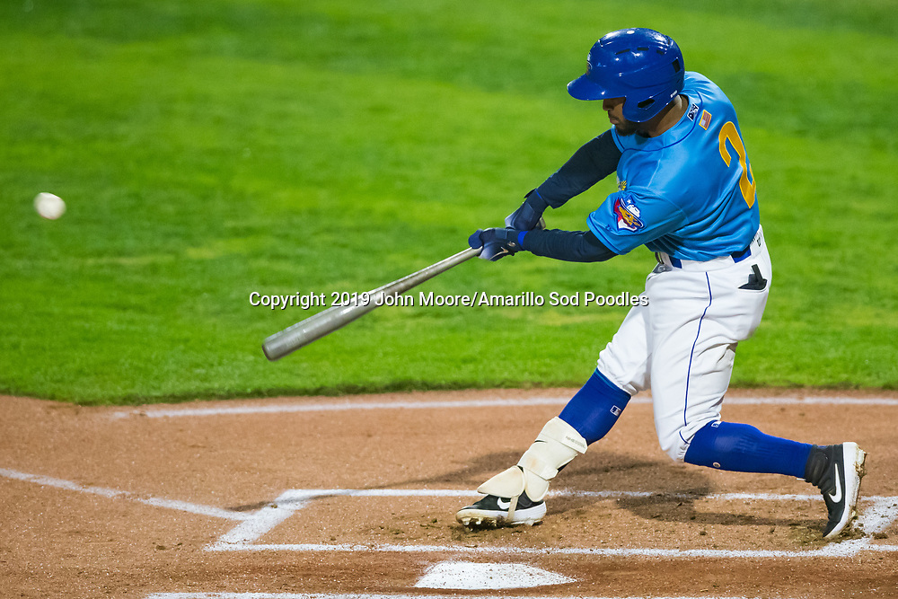 Amarillo Sod Poodles infielder Ivan Castillo (2) hits the ball against the Midland RockHounds on Thursday, May 23, 2019, at HODGETOWN in Amarillo, Texas. [Photo by John Moore/Amarillo Sod Poodles]