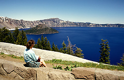 OR:  Oregon; Crater Lake National Park, At Crater Lake, model released      .Photo Copyright Lee Foster, lee@fostertravel.com, www.fostertravel.com, (510) 549-2202.Image orcrat203