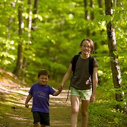 Two kids hiking in Skinner State Park in Hadley, Massachusetts.  Holyoke Range.  Connecticut River valley.