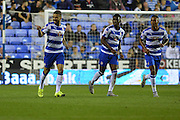 Reading's Carlos Orlando Sa (left) acknowledges the Reading bench after scoring his third goal during the Sky Bet Championship match between Reading and Ipswich Town at the Madejski Stadium, Reading, England on 11 September 2015. Photo by Mark Davies.