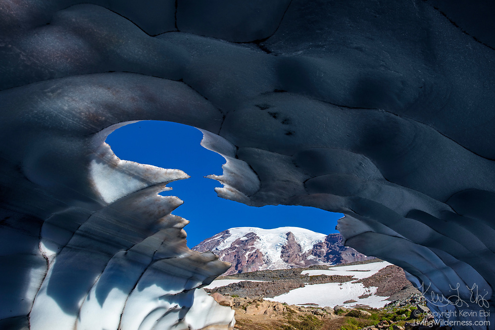 Mount Rainier is framed by the opening of an ice cave near the Skyline Trail in Mount Rainier National Park, Washington. At 14,411 feet (4,392 meters), Mount Rainier is the tallest mountain in Washington state and the highest point the Cascade mountain range.