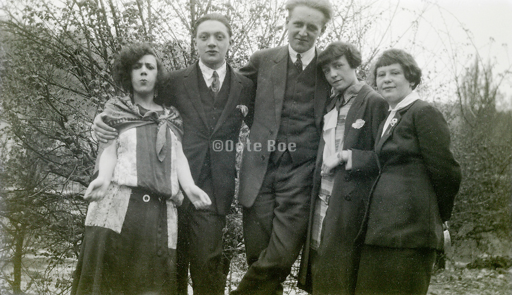 young adult men and women posing 1920s