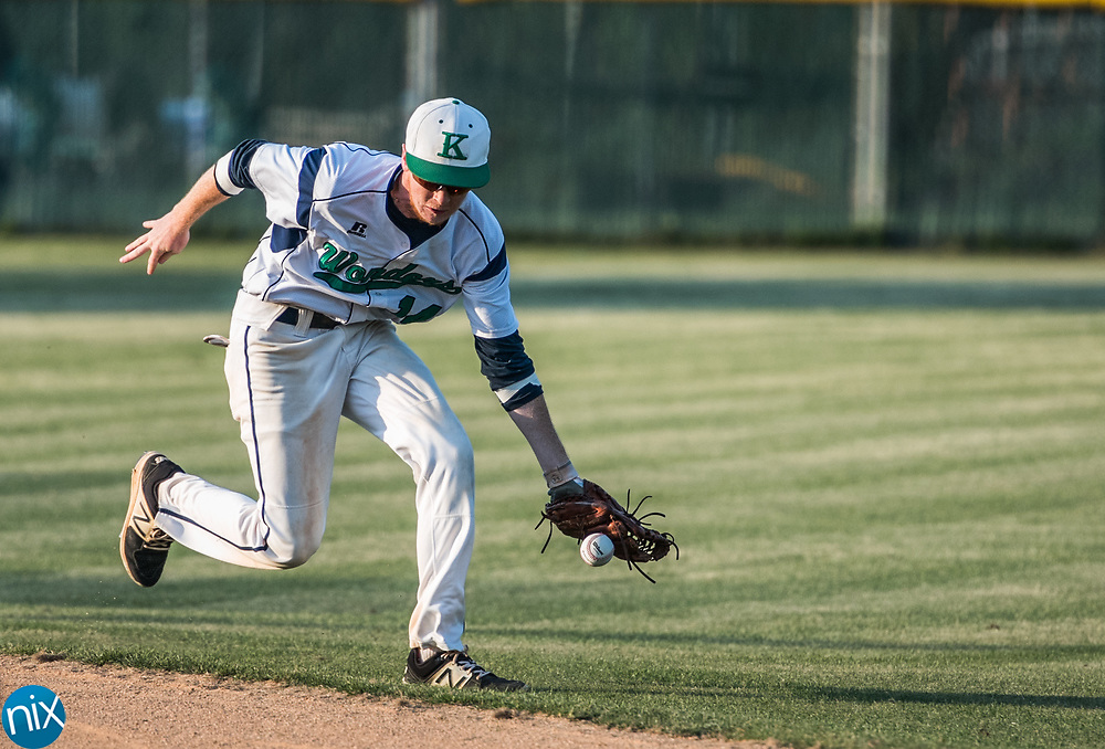 A.L. Brown's Lane Argabright (14) tries to field an infield grounder but misses against Charlotte Catholic in the first round of the NCHSAA playoffs at A.L. Brown High School Wednesday night in Kannapolis. A.L. Brown won 2-1 to advance.