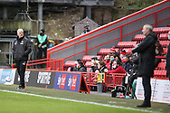 AFC Wimbledon manager Glyn Hodges and Charlton Athletic manager Lee Bowyer on touchline with AFC Wimbledon manager Glyn Hodges looking into crowd during the EFL Sky Bet League 1 match between Charlton Athletic and AFC Wimbledon at The Valley, London, England on 12 December 2020.