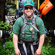 Portrait of Chris Kitchen of KGB Productions with loaded backpack.