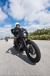 Iron Lilly Kristen Lassen on a 2014 Harley-Davidson Iron 883 Sportster as she rides A1A near Flagler Beach during Daytona Beach Bike Week. FL. USA. Tuesday, March 14, 2017. Photography ©2017 Michael Lichter.