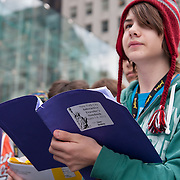 Teenager shool boy Deen Bessey with the notebook on interactive travels