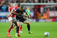 Doncaster Rovers midfielder Tommy Rowe (10) tries to keep the ball from Charlton Athletic midfielder Joe Aribo (17) during the EFL Sky Bet League 1 second leg Play-Off match between Charlton Athletic and Doncaster Rovers at The Valley, London, England on 17 May 2019.