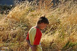 9 yr old boy walking alone in the countryside (Turkey) MR