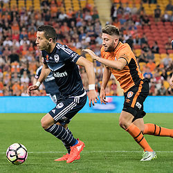 BRISBANE, AUSTRALIA - OCTOBER 7: Daniel Georgievski of the Victory controls the ball under pressure from Brandon Borrello of the Roar during the round 1 Hyundai A-League match between the Brisbane Roar and Melbourne Victory at Suncorp Stadium on October 7, 2016 in Brisbane, Australia. (Photo by Patrick Kearney/Brisbane Roar)