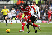 Cardiff City striker Kenwyne Jones and Derby County defender Richard Keogh challenge for the ball during the Sky Bet Championship match between Derby County and Cardiff City at the iPro Stadium, Derby, England on 21 November 2015. Photo by Aaron Lupton.