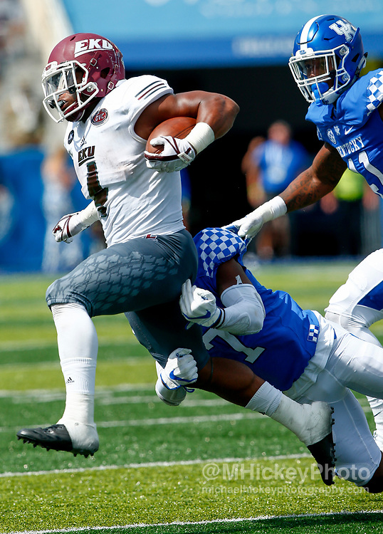 LEXINGTON, KY - SEPTEMBER 09: LJ Scott #4 of the Eastern Kentucky Colonels runs the ball as Mike Edwards #7 of the Kentucky Wildcats makes the tackle at Kroger Field on September 9, 2017 in Lexington, Kentucky. (Photo by Michael Hickey/Getty Images) *** Local Caption *** LJ Scott; Mike Edwards