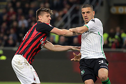 March 2, 2019 - Milan, Milan, Italy - Krzysztof Piatek #19 of AC Milan competes with Merih Demirl #3 of US Sassuolo during the serie A match between AC Milan and US Sassuolo at Stadio Giuseppe Meazza on March 02, 2019 in Milan, Italy. (Credit Image: © Giuseppe Cottini/NurPhoto via ZUMA Press)