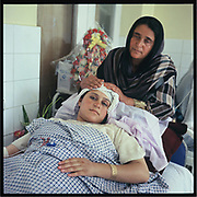 The mother comforts the daughter after she gave birth in Badakshan.