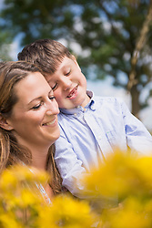 Mother with her son smiling in the countryside, Bavaria, Germany