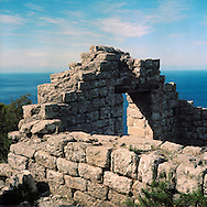 A the ruins of a mill used by the monk in the XVI century. The wheels where moved by the water that was forced in conduits  dug in the granit rocks. Montecristo is the most distant island of the Tuscan Arcipelago form the Italian coast. It's a cone of granite with rugge valleys and peaks, the highest, Monte Fortezza is 654 meters. It has been a wildlife reserve since 1971. Federico Scoppa/CAPTA