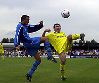 Picture: Henry Browne<br />Date: 19/07/2003<br />Burton Albion v Birmingham City Pre season friendly<br />Stan Lazaridis of City chips the ball over Terry Henshaw of Albion