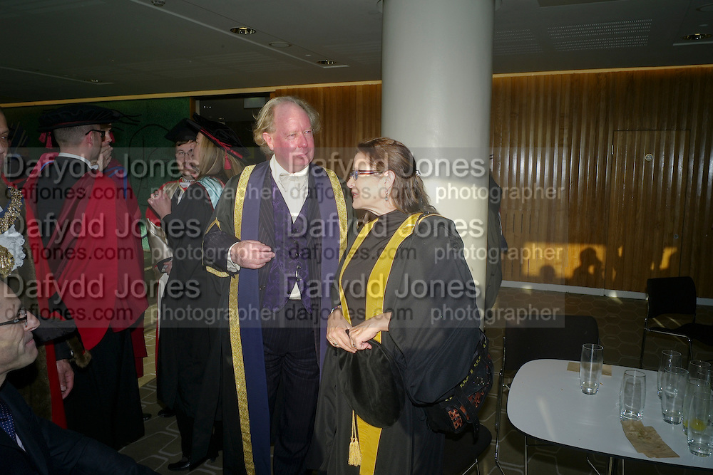 PRINCIPAL GAVIN HENDERSON; CARRIE FISHER;  . Central School of Speech and Drama presents Honory Fellowships to Carrie Fisher, Bette Bourne, Joseph Selig and Helen Lannaghan. Royal Festival Hall. London. 12 December 2011.