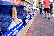 People walk past federal election posters for the Australian Labor Party showing now Prime Minister Julia Gillard. Midland, Perth, Western Australia