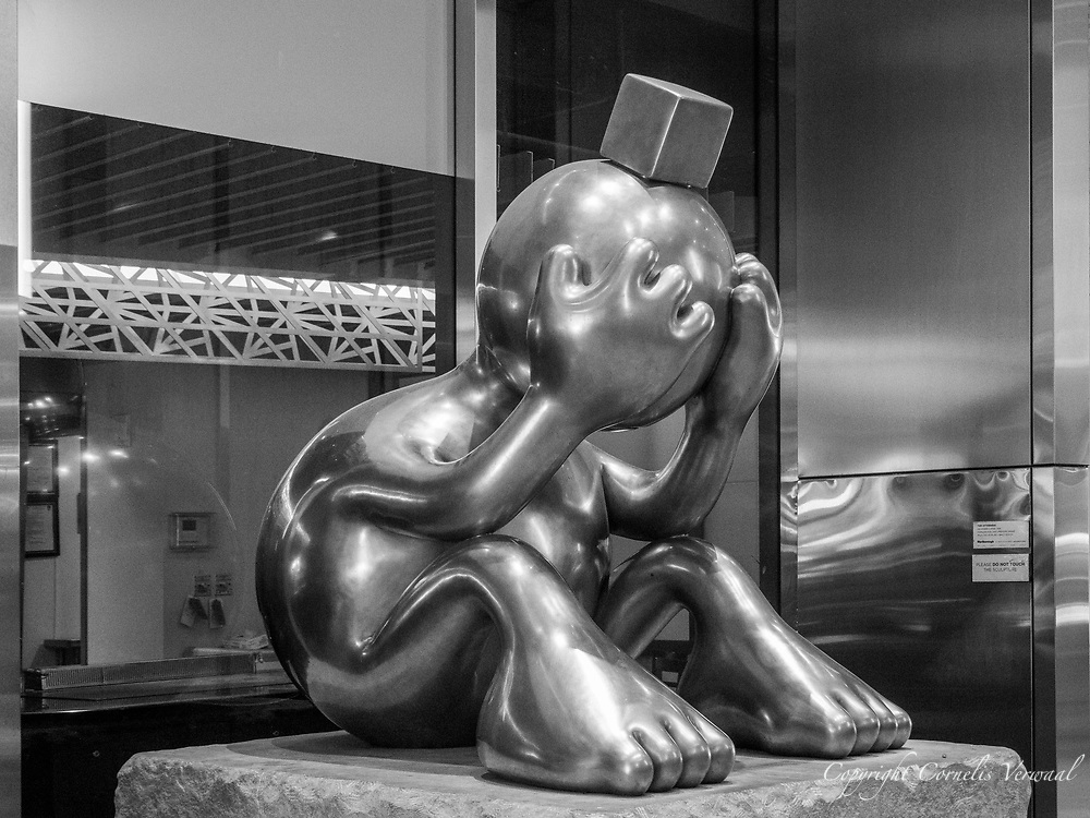 """""""Sad Sphere"""" by sculptor Tom Otterness at the Marlborough passage, 57th Street."""