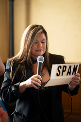 An unidentified emcee reads off the winners in the recipe contest at the 22nd annual Spam Festival, Sunday, Feb. 16, 2019, in Isleton, Calif. Spam lovers competed for prizes by presenting their favorite Spam-infused foods, or entering the Spam-eating and Spam-toss contests. (Photo by D. Ross Cameron)