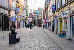 © Licensed to London News Pictures. 22/11/2020. Hull, UK. Photo credit:  Shoppers walk in Hull city centre. Hull is to face stricter measures following lockdown to reduce the spread of the Coronavirus, as 751.4 per 100000 people is reported, and the numbers keep increasing daily.  Photo credits:  Ioannis Alexopoulos/LNP