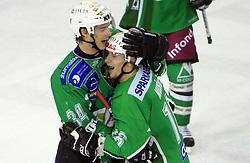 Ziga Pavlin and Ales Music at 39th Round of EBEL League ice hockey match between HDD Tilia Olimpija and Acroni Jesenice, on December 30, 2008, in Arena Tivoli, Ljubljana, Slovenia. Tilia Olimpija won 4:3.(Photo by Vid Ponikvar / SportIda).