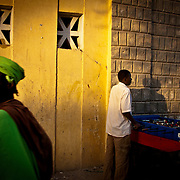 Young's playing in a soccer table in front of the Grand Marche, Timbuktu old town, Mali .