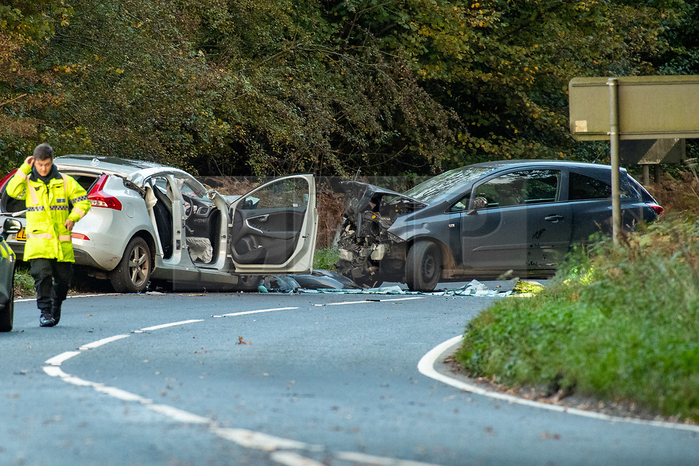 © Licensed to London News Pictures. 23/10/2020. Amersham, UK. Two extensively damaged vehicles involved in the collision in Homer Green block the A404. At approximately 15:22BST on Friday 23/10/2020 there was a road traffic collision on the A404 in Holmer Green, close to the junction with Sheepcote Dell Lane, between a blue Vauxhall Corsa and a white Volvo V40. Sadly the driver of the Vauxhall Corsa, a man in his fifties from Buckinghamshire, sadly passed away on Monday 26/10/2020. The driver of the white Volvo, a woman in her forties, suffered a serious injury, she remains in hospital in a stable condition. Her injuries are not believed to be life-threatening. Prior to this collision it is believed that the driver of the Vauxhall Corsa may have been involved in some sort of altercation with another driver of a Silver Ford Focus. Photo credit: Peter Manning/LNP