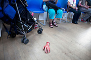 "A severed hand on the floor of the community centre. Stoke Newington Zombie-a-thon. Hundreds of people joined together in protest in North London to demonstrate against the planned opening of a large Sainsbury's supermarket. Dressed up as zombies the protesters were making the point that they should keep local shops in the area and not have the high street ruined by large chains. The action by Stokey Local says: ""In Stoke Newington, even the dead are rising up to say 'no' to a proposed Sainsbury's development."" Walking slowly as if in a zombie film the march culminated in passing a Sainsbury's Local supermarket on the High Street. In the middle of June it was announced that a development is being planned for Wilmer Place, just beside Abney Park Cemetery on the corner of Church Street and the High Street – right in the heart of Stoke Newington. The proposed development comprises a large Sainsbury's supermarket and 44 homes and has significant implications for the diversity of the local economy, local employment, transport & traffic, noise and safety and local heritage."