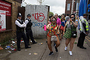Making fun of the police on Sunday 28th August 2016 at the 50th Notting Hill Carnival in West London. A celebration of West Indian / Caribbean culture and Europes largest street party, festival and parade. Revellers come in their hundreds of thousands to have fun, dance, drink and let go in the brilliant atmosphere. It is led by members of the West Indian / Caribbean community, particularly the Trinidadian and Tobagonian British population, many of whom have lived in the area since the 1950s. The carnival has attracted up to 2 million people in the past and centres around a parade of floats, dancers and sound systems.