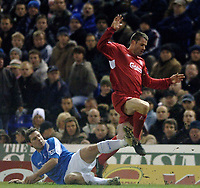 Photo: Glyn Thomas.<br />Birmingham City v Liverpool. The FA Cup. 21/03/2006.<br /> Liverpool's Jamie Carragher (R) is tackled by Muzzy Izzet.