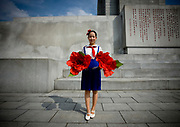 Fashion in North Korea<br /> <br /> In every corner of the earth, women love to look beautiful and keep up with the latest fashion trends. The women of North Korea are no different. Fashion is taken seriously here. But in North Korea, women do not read Elle or Vogue; they just glimpse a few styles by watching TV or by observing the few foreigners who come to visit. In the hermit kingdom, clothing also reflects social status. If you have foreign clothes it means you travel and are consequently close to the centralized power. Chinese products have inundated the country, adding some color to the traditional outfits that were made of vynalon fiber. But citizens beware, too much style means you're forgetting the North Korean juche, the ethos of self-reliance that the country is founded on! But the youth tend to neglect it despite the potential consequences.<br /> <br /> Photo shows: A pioneer girl wears this uniform from the ages of nine to fifteen. Proud of this outfit, many children wear it outside of the school hours. They love to customize their look with unique hairstyles and jewelry.  Students who refuse to wear the school uniform will be subject to punishment.<br /> ©Eric Lafforgue/Exclusivepix Media