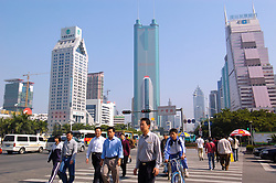 Pedestrians crossing street in central district of Shenzhen Guangdong Province China