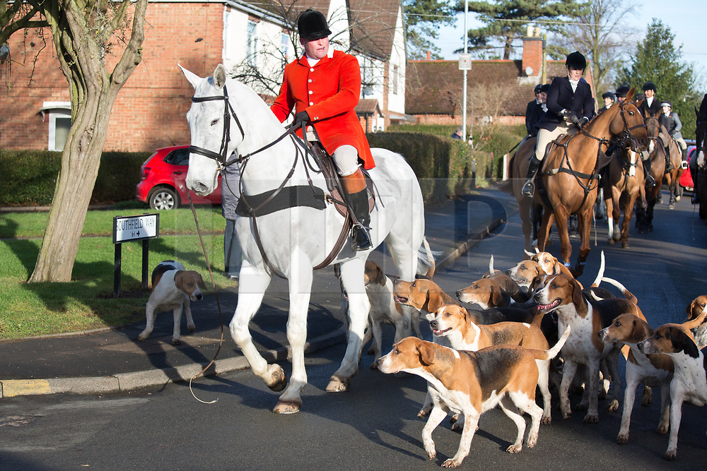 © Licensed to London News Pictures. 26/12/2017. Market Bosworth, Leicestershire, UK. The Hunt meeting in the Market Square, Market Bosworth earlier today. Pictured, the hunt makes it's way through the town centre. Photo credit: Dave Warren/LNP