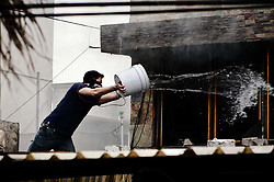 April 28, 2019 - April 28, 2019. Cuautitlan Izcalli, state of Mexico. At noon on this Sunday, a fire broke out in a house, marked with the number 94 of Cordilleras street, in the Atlanta neighborhood. Neighbors had to support, with buckets, the elements of firemen and public security, to put down the fire.  ..PHOTO: OMAR LOPEZ (Credit Image: © Omar LopezZUMA Wire)