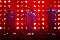 Bruno Mars performing on stage at the Brit Awards at the O2 Arena, London.