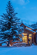 One of the studio buildings is illuminated at dusk as guests visit to tour the campus uring the annual Holiday Open House event at Anderson Ranch Arts Center in Snowmass Village, Colorado.