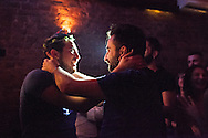 Omar (left) and Nader (right) hold each other after Omar accepted Nader's marriage proposal during Omar's birthday party in Istanbul, Turkey
