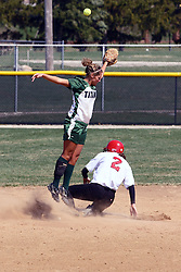 05 April 2008: Kari Peterson slides into 2nd safely as the ball thrown to 2nd was too high for Allison Ward to catch. The Carthage College Lady Reds lost the first game of this double header to the Titans of Illinois Wesleyan 4-1 at Illinois Wesleyan in Bloomington, IL