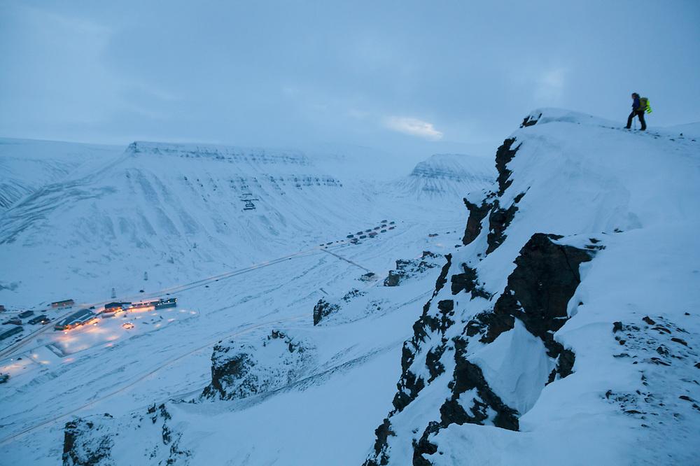 Mylène Jacquemart hikes out to a rim of Sverdruphamaren overlooking Longyearbyen, Svalbard.