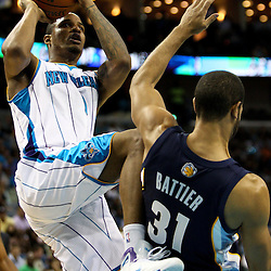 April 1, 2011; New Orleans, LA, USA; New Orleans Hornets small forward Trevor Ariza (1) shoots over Memphis Grizzlies small forward Shane Battier (31) during the second half at the New Orleans Arena. The Grizzlies defeated the Hornets 93-81.   Mandatory Credit: Derick E. Hingle