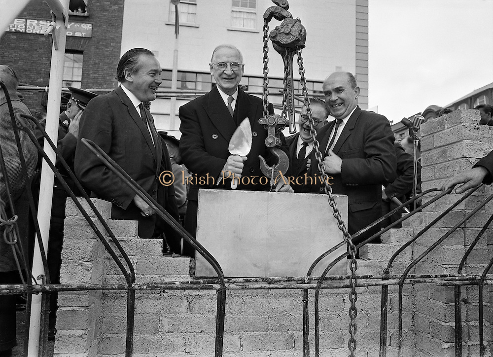 The President lays the foundation stone of the new Abbey Theatre, on the site of the old theatre which burned down. On the left is the architect Mr Michael Scott. .03.09.1963