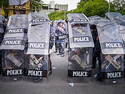 23 NOVEMBER 2012 - BANGKOK, THAILAND:   Thai riot police drill near Government House in Bangkok Friday. Thai authorities have imposed the Internal Security Act (ISA), that enables police to call on the army if needed to keep order, and placed thousands of riot police in the streets around Government House in anticipation of a large anti-government protest Saturday. The group sponsoring the protest, Pitak Siam, said up to 500,000 people could turn out to protest against the government. They are protesting against corruption in the current government and the government's unwillingness to arrest or pursue fugitive former Prime Minister Thaksin Shinawatra, deposed in 2006 coup and later convicted on corruption charges. The current Thai Prime Minister is Yingluck Shinawatra, Thaksin's sister.     PHOTO BY JACK KURTZ