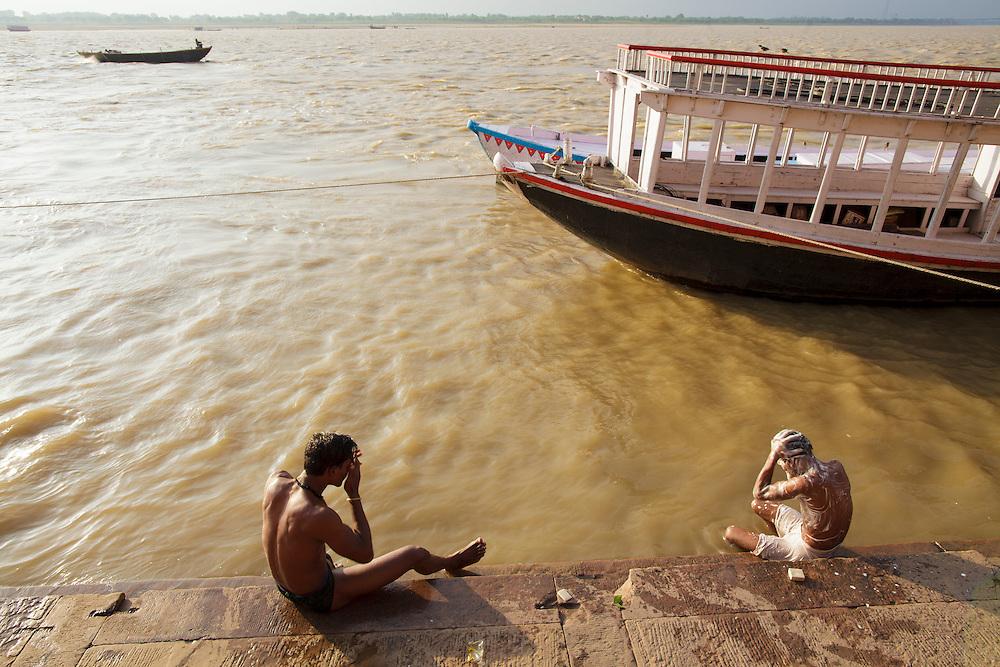 Hindu men bathing at Rana Ghat  by the Ganges river in Varanasi, India.
