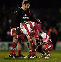 Photo: Jed Wee.<br /> Doncaster Rovers v Arsenal. Carling Cup. 21/12/2005.<br /> <br /> Doncaster players show their disappointment.