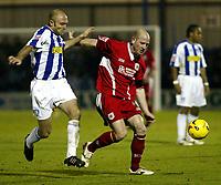 Photo: Chris Ratcliffe.<br />Colchester United v Bristol City. Coca Cola League 1. 17/01/2006.<br />Colchester's Wayne Brown challenges Steve Brooker of Bristol.