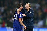 Cardiff city manager Neil Warnock with Craig Bryson of Cardiff city at the end of the match. EFL Skybet championship match, Cardiff city v Leeds Utd at the Cardiff city stadium in Cardiff, South Wales on Tuesday 26th September 2017.<br /> pic by Andrew Orchard, Andrew Orchard sports photography.